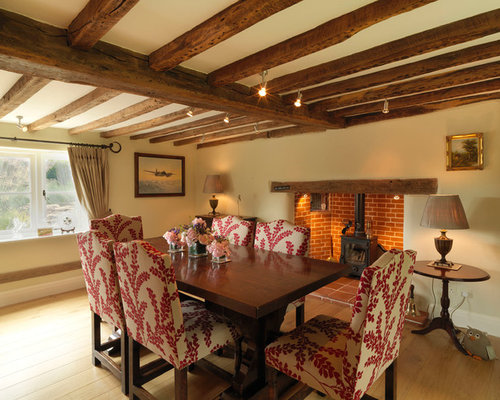 Photo Of A Large Rural Enclosed Dining Room In Hampshire With Beige Walls Medium Hardwood