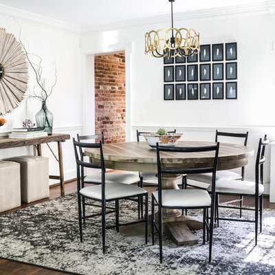 Example of a mid-sized transitional dark wood floor and brown floor enclosed dining room design in Austin with white walls and no fireplace