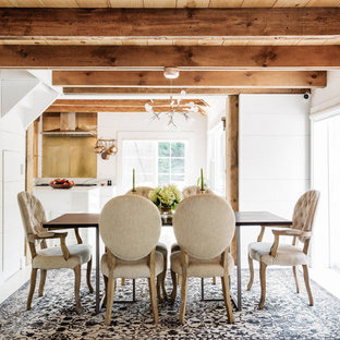Enclosed dining room - small cottage light wood floor and white floor enclosed dining room idea in New York with white walls