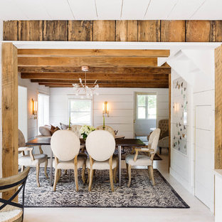 Example of a small cottage light wood floor and white floor enclosed dining room design in New York with white walls