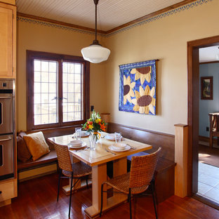 Arts and crafts medium tone wood floor kitchen/dining room combo photo in Minneapolis with beige walls