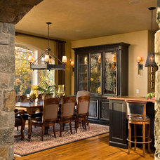 Rustic Dining Room by Witt Construction
