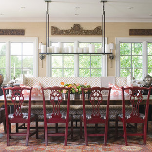 Elegant dining room photo in Denver with beige walls
