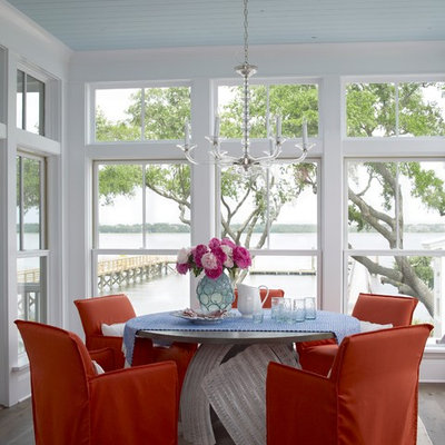 Kitchen/dining room combo - coastal medium tone wood floor kitchen/dining room combo idea in Charleston with white walls