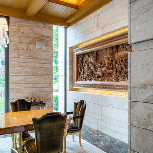 Example of a marble floor dining room design in Cleveland