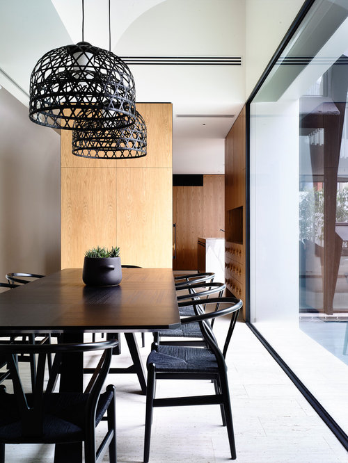 Photo Of A Mid Sized Contemporary Kitchen Dining Combo In Sydney
