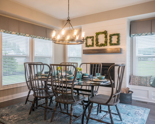 example of a country dark wood floor and gray floor dining room design in columbus with - Farmhouse Dining Room Ideas
