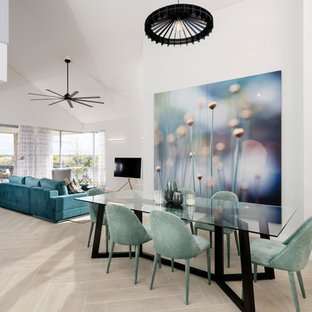Contemporary open plan dining in Perth with light hardwood floors, beige floor and white walls.