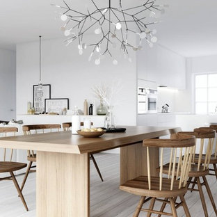 Example of a danish light wood floor and white floor great room design in Richmond with white walls