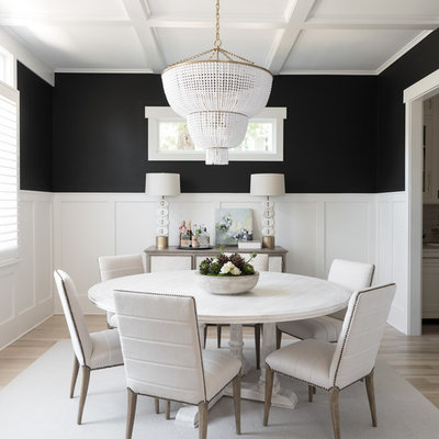 Inspiration for a transitional light wood floor and beige floor enclosed dining room remodel in Charlotte with black walls