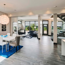 Contemporary Dining Room by New West Group of Companies