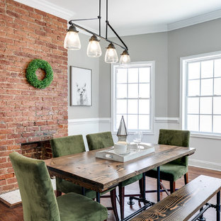 Inspiration for a transitional medium tone wood floor dining room remodel in Richmond with gray walls, a standard fireplace and a brick fireplace