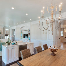 Tropical Dining Room by Emerald Coast Real Estate Photography