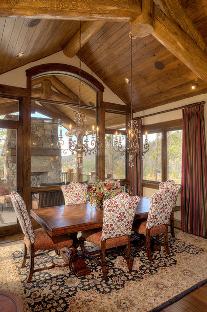 Rustic Dining Room by Pinnacle Mountain Homes