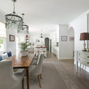 Example of a mid-sized transitional brown floor and dark wood floor great room design in Charleston with white walls