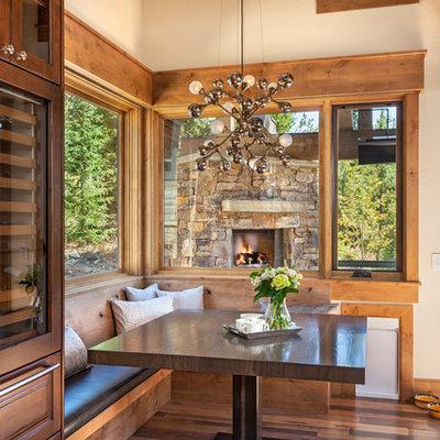 Dining room - rustic medium tone wood floor dining room idea in Denver with beige walls
