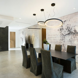 Large trendy concrete floor and beige floor enclosed dining room photo in Los Angeles with white walls and no fireplace