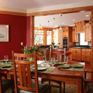 Dining room - craftsman dining room idea in Seattle with red walls