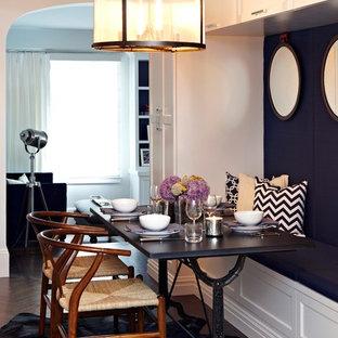 Ispirazione per una piccola sala da pranzo aperta verso il soggiorno tradizionale con pareti grigie, parquet scuro e nessun camino