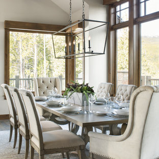 Dining room - transitional dark wood floor and brown floor dining room idea in Denver with white walls