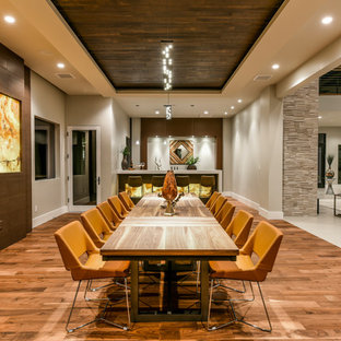 Inspiration for a contemporary medium tone wood floor and brown floor great room remodel in Las Vegas with gray walls