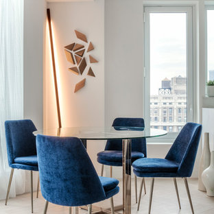 Inspiration for a mid-sized scandinavian light wood floor and beige floor dining room remodel in New York with white walls