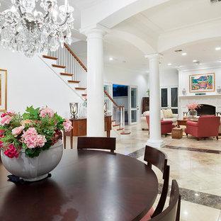 Ispirazione per una grande sala da pranzo aperta verso il soggiorno chic con pareti bianche, pavimento in marmo, camino classico, cornice del camino in intonaco e pavimento multicolore