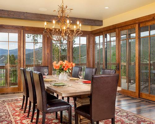 Ex&le of a classic dark wood floor dining room design in Denver with yellow walls & Wood Door Casing   Houzz