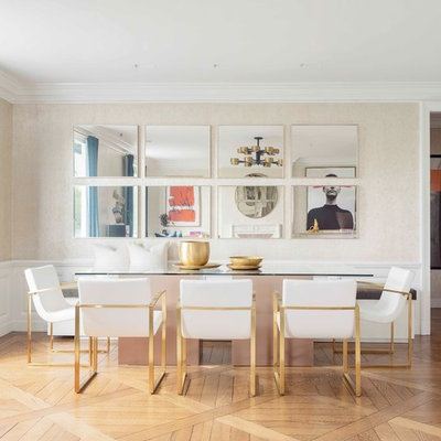 Inspiration for a contemporary medium tone wood floor and brown floor dining room remodel in New York with beige walls