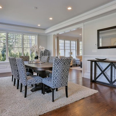 Large transitional medium tone wood floor and brown floor enclosed dining room photo in Boston with gray walls and no fireplace