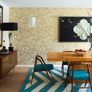 Design ideas for a contemporary dining room in New York with white walls and medium hardwood flooring.