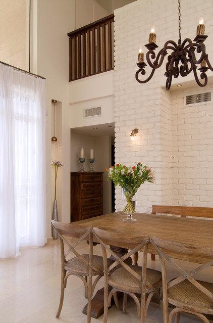 Mediterranean Dining Room by NURIT GEFFEN-BATIM STUDIO