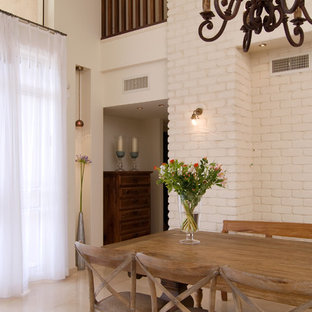 Dining room - mediterranean dining room idea in Other with white walls