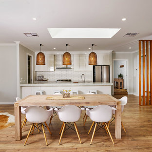 Country open plan dining in Other with medium hardwood floors, brown floor and grey walls.