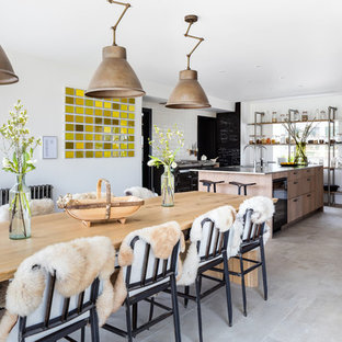 Design ideas for a rural kitchen/dining room in Gloucestershire with white walls, no fireplace and grey floors.