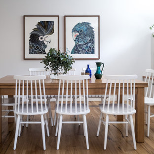Inspiration for a small country open plan dining in Melbourne with white walls, no fireplace, medium hardwood floors and brown floor.