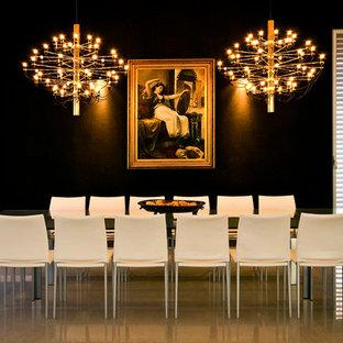 Minimalist dining room photo in Tel Aviv with black walls