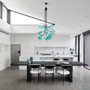 Design ideas for a large contemporary kitchen/dining combo in Melbourne with concrete floors, grey floor, white walls and no fireplace.