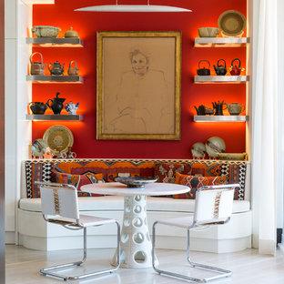 Foto de comedor ecléctico, sin chimenea, con paredes rojas y suelo de madera clara