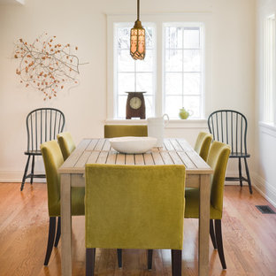 Dining room - traditional medium tone wood floor dining room idea in Kansas City with white walls