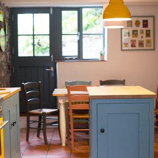 Enclosed dining room - small contemporary terra-cotta floor enclosed dining room idea in Other