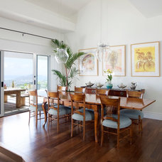 Tropical Dining Room by Barker Kappelle Construction, LLC