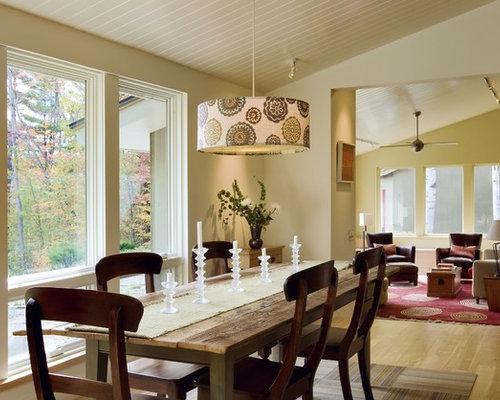 Example Of A Trendy Medium Tone Wood Floor Dining Room Design In Burlington  With Beige Walls