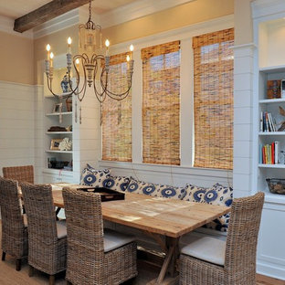 Example of a mid-sized coastal medium tone wood floor kitchen/dining room combo design in Miami with yellow walls
