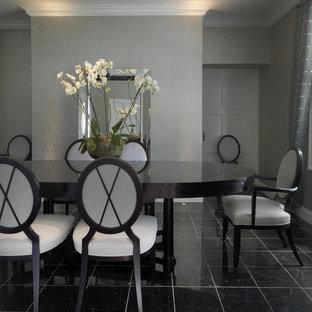 Ejemplo de comedor clásico, grande, cerrado, con suelo de mármol y paredes grises