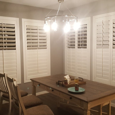Mid-sized transitional dark wood floor and brown floor enclosed dining room photo in Phoenix with gray walls and no fireplace