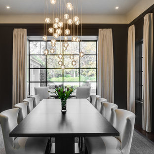 Inspiration for a transitional dark wood floor and brown floor enclosed dining room remodel in Atlanta with black walls