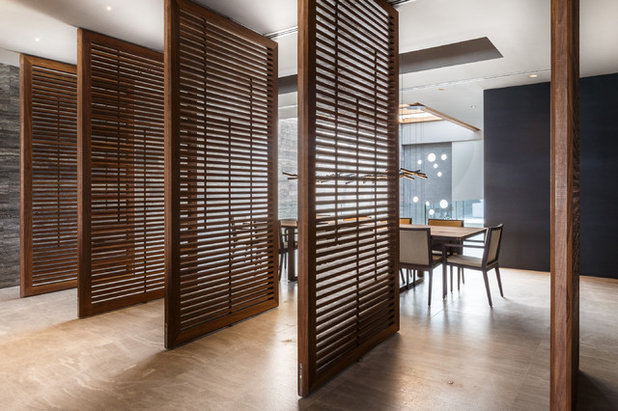 Contemporary Dining Room by Moriq