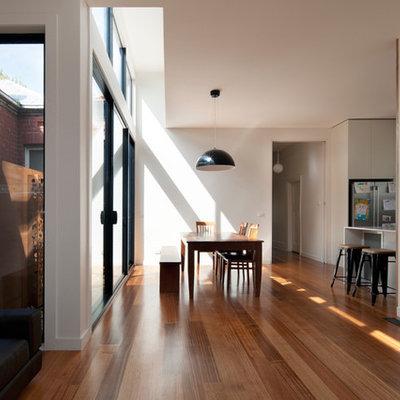 Trendy dining room photo in Melbourne with white walls
