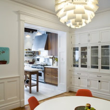 eclectic dining room by Abelow Sherman Architects LLC